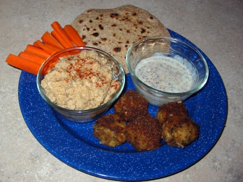 Platter with falafel, hummus, roti and yogurt dip