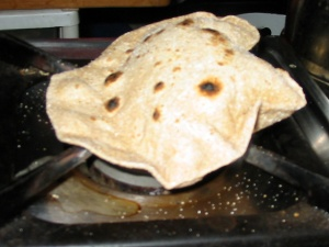 Puffing the Roti over open flame